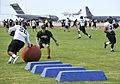 Chris Wiesehan, center, an assistant coach for the University of Hawaii football team, runs a drill during a practice at Joint Base Pearl Harbor-Hickam Aug. 15, 2013, in Hawaii 130815-N-IU636-234.jpg