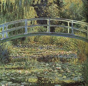 Giverny - The water lily pond in Monet's garden at Giverny shown in his The Waterlily Pond, green harmony (1899)