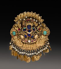 Pendant with Two-Armed Blue Deity on a Lotus with Nagas (serpent divinities) (1915.341)