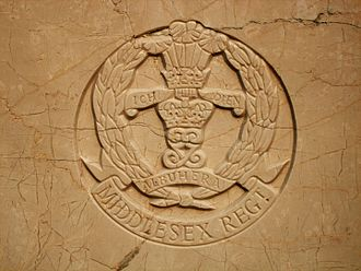 Middlesex Regiment - Badge of the Middlesex Regiment as shown on a Second World War grave at Stanley Military Cemetery, Hong Kong.