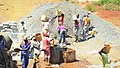 Construction site workers loading water, sand, ballast and cememt into a concrete mixer in Embu, Kenya 6 a.jpg