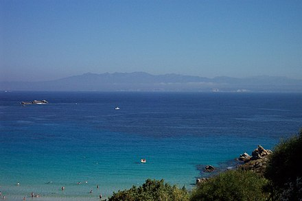Strait of Bonifacio. The southern coast of Corsica can be seen from Santa Teresa Gallura Corsica from Sardinia.jpg