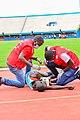 Croix rouge helping young person in Athletisme at Amahoro stadium kigali RWANDA.jpg