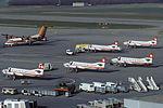 Crossair Fairchild Swearingen SA-227AC Metro III and Tyrolean Airways Dash 7 at Zurich Airport.jpg