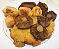 Cutlet, potatoes, rakes. Traditional Polish dinner. Poznan.jpg