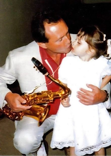 With his granddaughter Katie in 1987 at the Lincoln Center Dad Katie 1987 Lincoln Center2.jpg