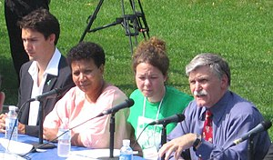 Justin Trudeau - Left to right at a Darfur rally, 2006: Trudeau, Darfurian refugee Tragi Mustafa, one of the event organisers, and Senator Roméo Dallaire