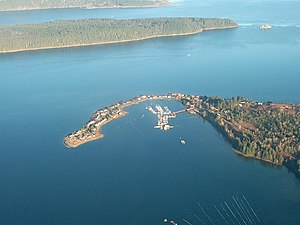Deep Bay, British Columbia - Aerial view of Deep Bay Marina with Baynes Sound, Denman Island (Chrome Island Light off its tip) and Hornby Island in the background.