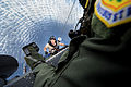 Defense.gov News Photo 110901-F-GY326-631 - U.S. Air Force Pararescueman Staff Sgt. Jacob Schaumberg is hoisted up to an HH-60 Pave Hawk helicopter by Master Sgt. John Durbin of the 33rd Rescue.jpg