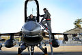 Defense.gov News Photo 120131-F-CJ989-907 - Capt. Jason Blodzinski a 77th Fighter Squadron pilot talks with his crew chief Senior Airman Frank Brown also with the 77th Fighter Squadron.jpg