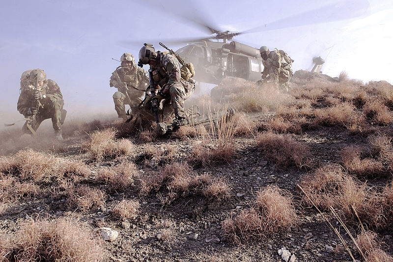 File:Defense.gov News Photo 120225-N-BV659-316 - U.S. Special Operations personnel take cover to avoid flying debris as they prepare to board a UH-60 Black Hawk helicopter during a mission in.jpg