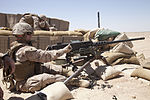Defense.gov News Photo 120628-M-CV710-071 - U.S. Marine Corps Cpl. Andrew C. Bell loads ammunition into an M2 .50-caliber heavy machine gun while training at Camp Leatherneck in Helmand.jpg