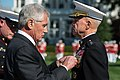 Defense Secretary Chuck Hagel pins a medal on outgoing Marine Corps Commandant Gen. James F. Amos during a change-of-command ceremony on Marine Barracks in Washington, D.C 141017-N-AF077-131c.jpg