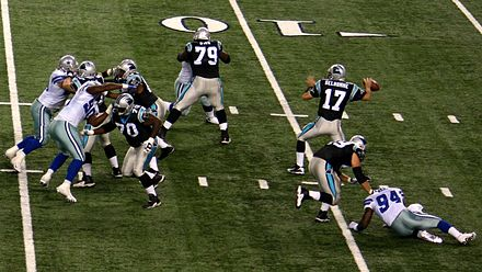 Carolina Panthers quarterback Jake Delhomme (number 17) in the motion of throwing a forward pass Delhomme goes deep.jpg