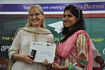 Deputy Director USAID Punjab Maggie Schoch presenting scholarship certificates to students under USAID's Merit and Needs Based Scholarship Program. (18056540814).jpg