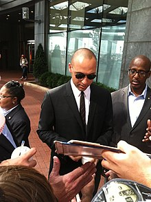 Jeter signing autographs.
