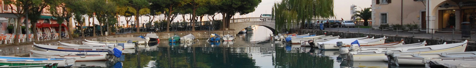 Desenzano del Garda banner Small boat harbour and bridge.jpg