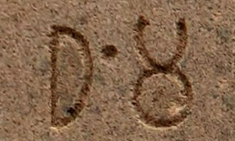 "The Prakrit word ""Dha-m-ma""/ (Sanskrit: Dharma dhrm) in the Brahmi script, as inscribed by Emperor Ashoka in his Edicts of Ashoka (3rd century BCE). Dhamma inscription.jpg"
