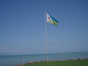 Flag of Djibouti - Djibouti Flag flying near the Sea.