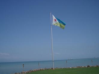Flag of Djibouti - Djibouti Flag flying near the Sea.
