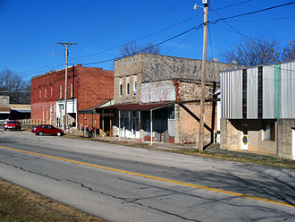 """Seligman, Missouri - Downtown Seligman, Missouri. Drew Wilkerson's original general store, also known as """"The Brick"""" sits on the corner on the left."""