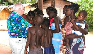John Chittick - Dr. John speaking with African women and boys