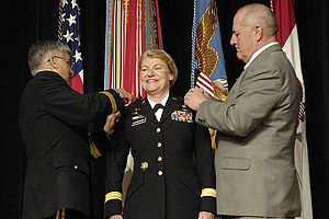Ann E. Dunwoody - Dunwoody is pinned with her four stars by Army Chief of Staff General Casey and her husband Craig Brotchie.