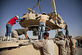 DynCorps International employees lower the turret of a U.S. Marine Corps M1 Assault Breacher Vehicle assigned to the 3rd Combat Engineer Battalion, Regimental Combat Team 7 at Camp Leatherneck in Helmand 130523-M-QZ858-102.jpg