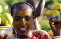 ETHIOPIA,HARAR GIRL SELLING FRUITS.png