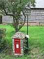 Edmondsham, postbox No. BH21 115 and old post office sign - geograph.org.uk - 944381.jpg