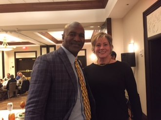 Evander Holyfield - Holyfield with Olympic weightlifting champion Karyn Marshall at a ceremony honoring him in 2016.