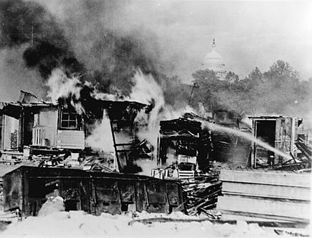 Shacks on the Anacostia flats, Washington, D.C. put up by the Bonus Army (World War I veterans) burning after the battle with the 1,000 soldiers accompanied by tanks and machine guns, 1932[176]