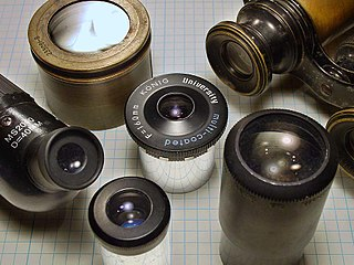Eyepiece type of lens attached to a variety of optical devices such as telescopes and microscopes; usually the lens that is closest to the eye when someone looks through the device, placed near the focal point of the objective to magnify the image