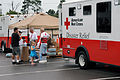 FEMA - 38149 - Red Cross truck and residents at the DRC in DeBary, FL.jpg