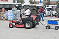 FEMA - 38342 - A resident riding his lawn mower into a food distribution center.jpg
