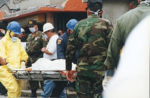 Humberto Vidal explosion - A survivor is carried out after being rescued from the rubble.