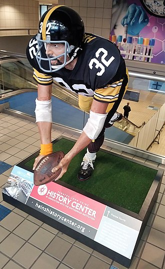 "Franco Harris - Statue of Harris making the ""Immaculate Reception"" at Pittsburgh International Airport."