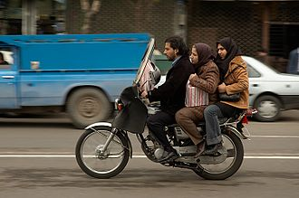 Motorcycling - Three riders on a motorcycle in Tehran