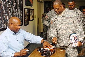 Bo Jackson - Jackson signing autographs for American soldiers in September 2007.