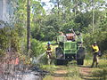 Firefighters mop-up a fireline during a prescribed fire at Florida Panther NWR (8120031654).jpg