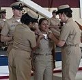 Flickr - Official U.S. Navy Imagery - A new chief receives her anchors..jpg