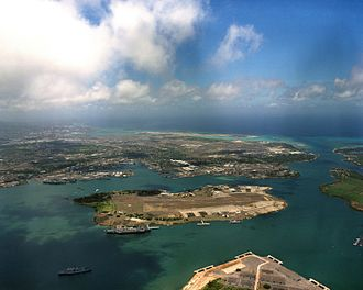 Pearl Harbor - Aerial view of Pearl Harbor, Ford Island in center. The Arizona memorial is the small white dot on the left side above Ford Island