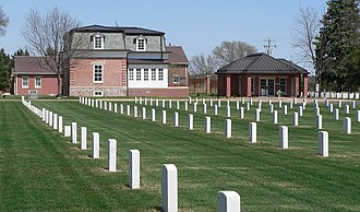 National Register of Historic Places listings in Lincoln County, Nebraska - Image: Ft. Mc Pherson National Cemetery headstones and lodge 1