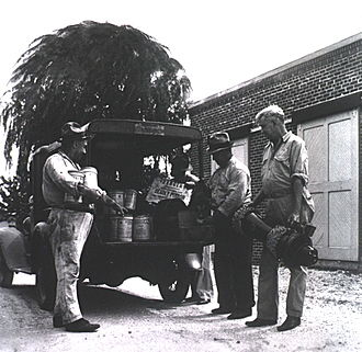 Zyklon B -  A fumigation team in New Orleans, 1939. Zyklon canisters are visible.