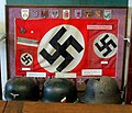 German WW2 swastika flag, Luftwaffe paratrooper (Fallschirmjäger) helmets, badges, decorations, etc. Stratford Armouries, Arms and Armour museum near Stratford-upon-Avon, England.jpg