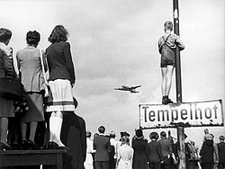 Germans watching Western supply planes at Berlin Tempelhof Airport during the Berlin Airlift, 1948