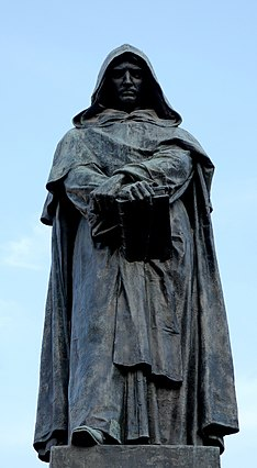 An ancient sculpture that show Giordano bruno dressed as a Monk holding a book.Athmosphere pretty dark even the sky behind is blue.