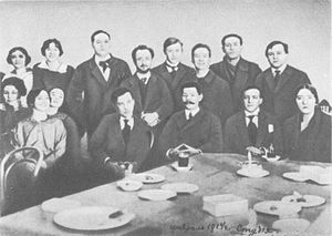 Stanislavski's system - Gorky (seated, centre) with Vakhtangov (right of Gorky) and other members of the First Studio, an institution devoted to research and pedagogy, which emphasised experimentation, improvisation, and self-discovery.