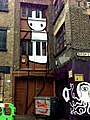 Graffiti in Shoreditch, London - Large Doorway by Stik (9425010250).jpg