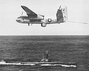 Grumman S2F-3 Tracker of VS-36 in flight over USS Sirago (SS-485), in 1962.jpg